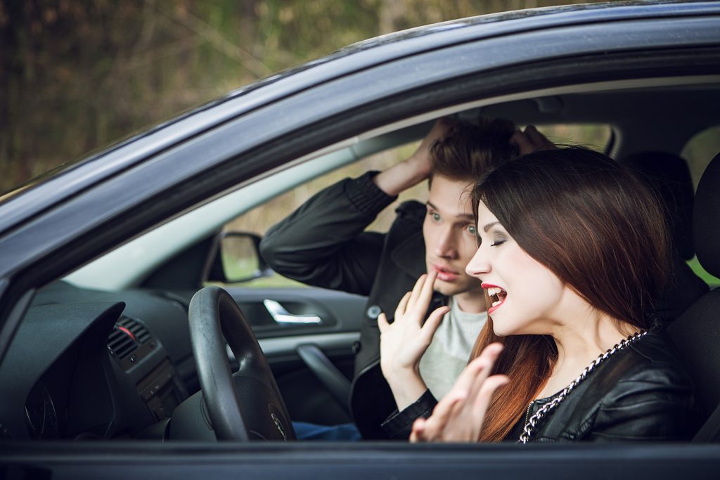 quarrel in the car, the couple quarrel in the car, the woman behind the wheel of a car